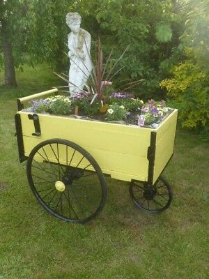 chimney sweep cart now converted to flower cart