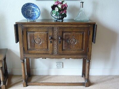 An antique small sized oak cabinet on framed legs