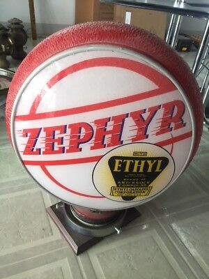 Zephyr with Ethyl original gas pump glass globe. In excellent condition.