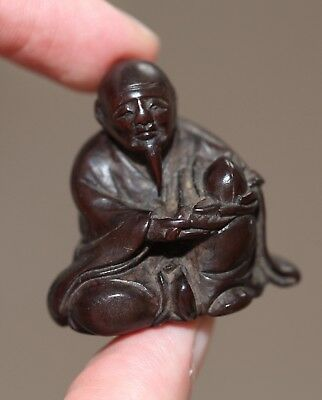 antique Japanese carved Boxwood Netsuke Old Man & peach, signed Yuzan, Meiji.