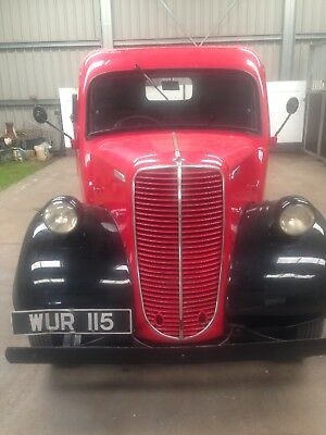 Red ford thames 1957 pick up truck