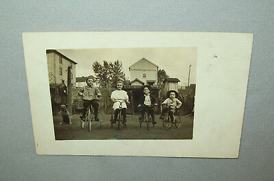 Old Antique Vtg Ca 1910s Four Kids on Trikes W/Dog Real Photo Post Card RPPC PC