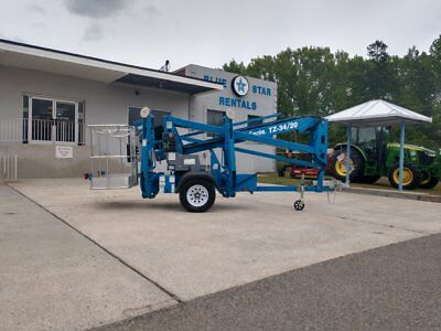 2013 Genie TZ34/20 Trailer-mounted boom lift, Tow-able Low 116.5 hours