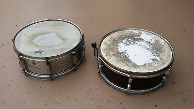 two snare drums 1 x pearl steel snare drum + other timber shell