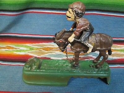 Cast Iron Mechanical Bank Bucking Horse And Rider In Good Condition