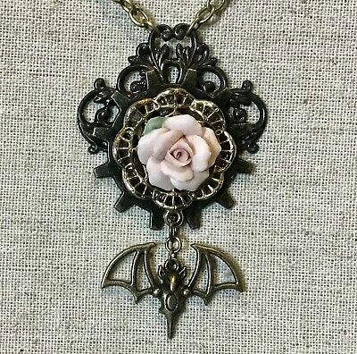 Gothic/ Steampunk necklace- Vintage Rose Piece On Gear W/ Bat Charm