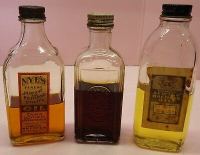 3 Glass Antique Sewing Bottles. Singer, Free & Nye All with Oil
