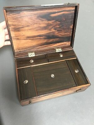 Antique wooden box with removable compartments with sliding lids.