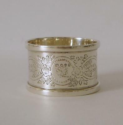 An Ornate Flower Decorated Victorian Sterling Silver Napkin Ring London 1882
