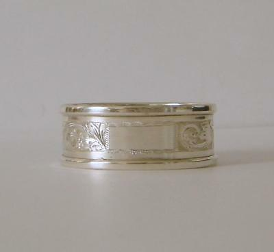 An Ornately Engraved Oval Shaped Sterling Silver Napkin Ring Birmingham 1965