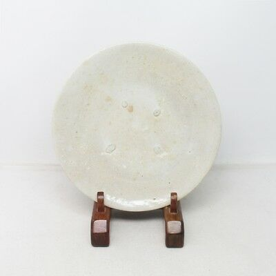 B685: Korean plate as flat tea bowl of old white porcelain of Joseon-Dynasty age
