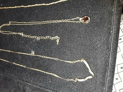 Gold coloured necklaces x 5 and one item that needs a chain
