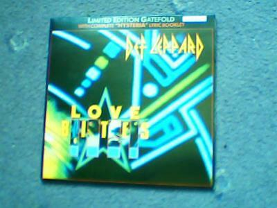 "def leppard love bites ltd 3 track vinyl 7"" with 'hysteria' lyric booklet"