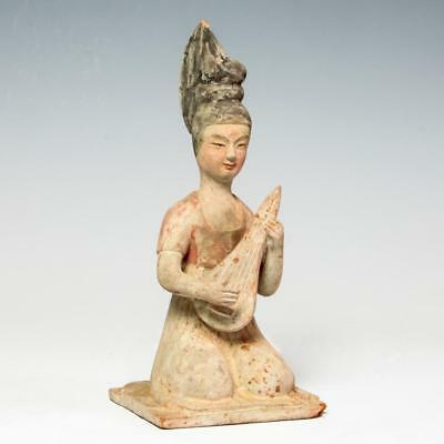 Chinese Tang dynasty pottery seated female musician circa 7th century AD.
