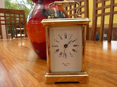 BRASS CARRIAGE CLOCK by Bornand Freres