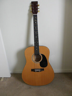 C. Giant full size steel string acoustic guitar