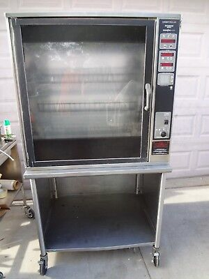Refurbished Henny Penny Scr-8 Electric Rotisserie Oven W/ Stand And Baskets.