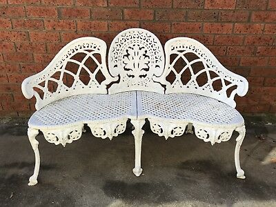 Antique cast iron bench love seat.