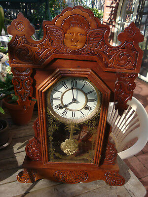 "Antique Waterbury ""Clayton""  Gingerbread Clock RunsStrikes well  great cond"
