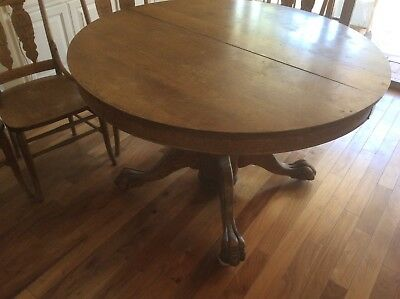 """Antique Oak table and chairs. 48"""" round to 92-3/4"""" oval Massive claw feet."""