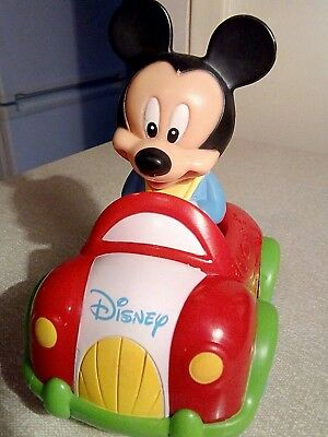 Micky Mouse in a car that  makes sounds