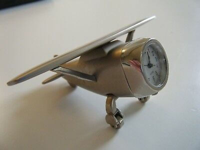 miniature novelty clock in form of aeroplane, working order, no battery