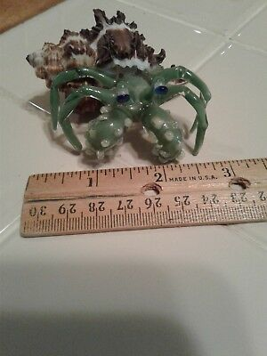 Art glass hermit crab figurine in real sea shell