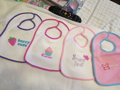 Baby Bibs Lot of 4 used colorful designs, sticky pad closure