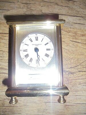 Taylor Bligh Brass Cased Carriage Clock With Solid Hallmarked Silver Dial.