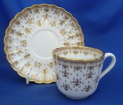 A Spode 'fleur De Lys Gold' Tea Cup And Saucer