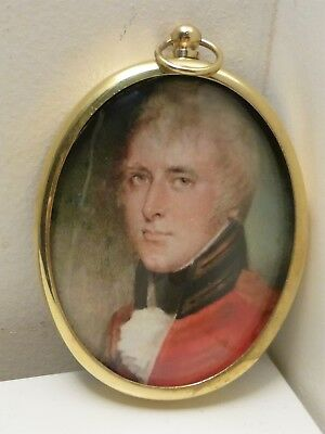 Portrait Miniature of handsome army officer wearing red coat in oval brass frame