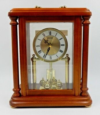 Seiko Mantel Clock With Rotating Pendulum Wooden Carriage ~ Model Qxg332Blh