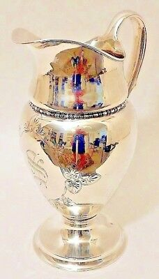 A tall sterling silver water pitcher, Tiffany & Co., New York, c.1902-7.