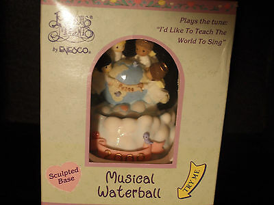 Enesco Musical Waterball 2000- Plays I'd Like To Teach The World To Sing..