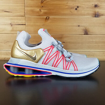 factory authentic 4eb72 1e5f6 Nike Shox Gravity Mens Olympic Shoe Sizes Vast Grey Metallic Gold AQ8553 009