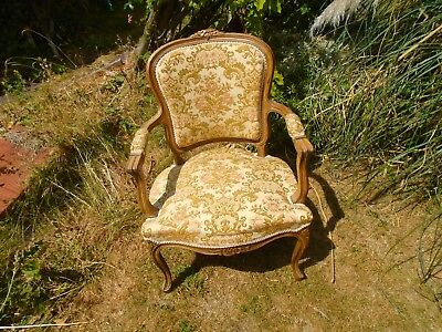 louis xv style french carved oak armchair.