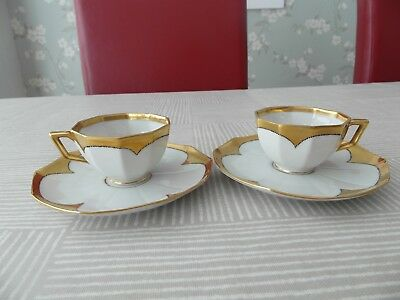 A Pair Of Art Deco  Aelteste Volkstedter Thuringia Heavily Gilded Cups & Saucers