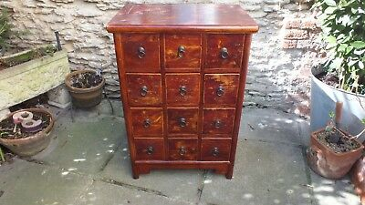 Antique Chinese Redwood flight of 12 drawers