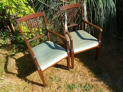 pair of antique edwardian mahogany and satinwood inlaid armchairs.