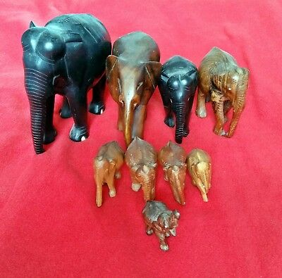 Collection of 9 Vintage Hand Carved Wooden Elephant Ornaments