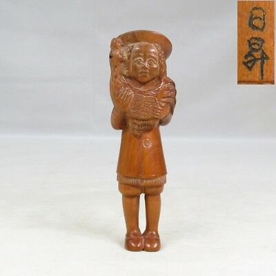D909: Japanese TSUGE boxwood carving NETSUKE of popular Westerners statue