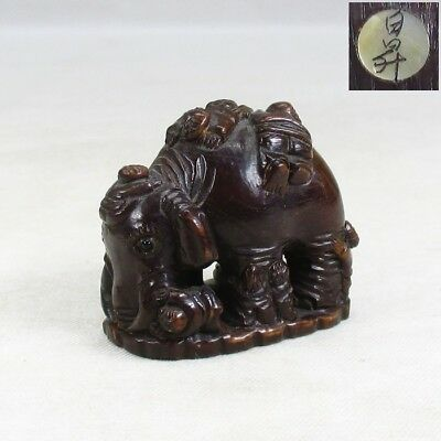D910: Japanese TSUGE boxwood carving NETSUKE of elephant with children image