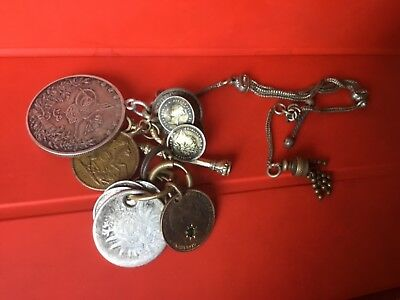 A mysterious collection of coins on a charm chain - Victorian