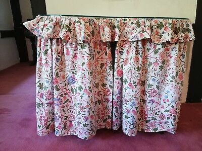 Vintage kidney shaped dressing table with floral Sanderson curtains and top