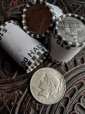 Half Dollar Coin Roll And One 90% Silver Peace Dollar- Unsearched Bank Sealed