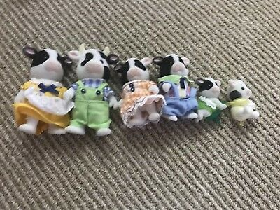 Calico critters/sylvanian Friesian Cow family of 6