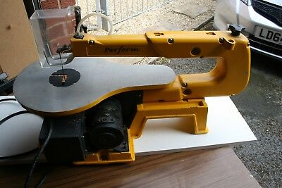 Perform Fret/ Scroll saw with blade, Heavy duty cast base and arm. Blade guard.