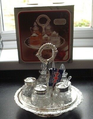 5 piece condiment set on silver plated revolving stand, boxed, England