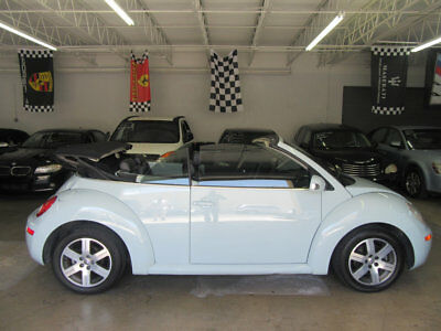 Volkswagen New Beetle Convertible 2dr 2.5L Automatic $4,800 includes SHIPPING! 74,000 mile Acquarius blue on black leather Florida