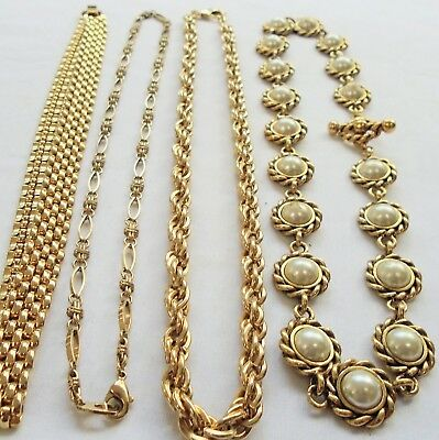 Four good quality vintage gold metal necklaces (pearl)